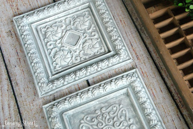 Painted metal tiles. Using thrift store items to create your own unique and inexpensive home decor. http://canarystreetcrafts.com/