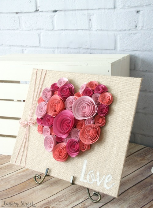 Curl paper flowers and glue them to a burlap canvas. Would be cute for Valentine's Day or even as wedding or bridal shower table decor. http://canarystreetcrafts.com/
